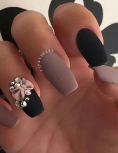 Matte nude & black with rhinestones & bow by @nailss