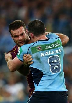 Paul Gallen of the Blues punches Nate Myles of the Maroons during game one of the ARL State of Origin series between the New South Wales Blues and the Queensland Maroons at ANZ Stadium on June 2013 in Sydney, Australia. Rugby League, Rugby Players, Blue Punch, Hard Earned, Sydney Australia, South Wales, Tennis, Blues, June