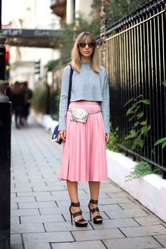 Kerry Pieri in Alaia shoes and Erin Dana belt bag. Cropped top paired with pleated skirt.