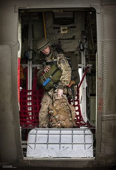 A paratrooper of B Company of 2nd Battalion The Parachute Regiment boards a Royal Air Force C-130J Hercules during Exercise Capable Eagle.