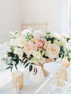 Turning a favorite getaway spot into a gorgeous destination wedding blush and gold romantic wedding centerpiece low and lush roses greenery mightylinksfo