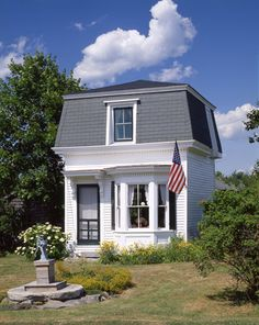 Adorable 300 sq ft mansard roof cottage in Maine.  article and more pics here: http://www.oldhouseonline.com/little-mansard-cottage/