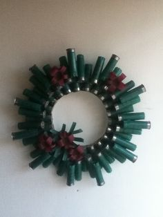 Made this entirely from shot gun shells, I collected when out shooting targets with man. Ammo Crafts, Hunting Crafts, Bullet Crafts, Diy Crafts Jewelry, Shotgun Shell Art, Shotgun Shell Wreath, Shotgun Shell Crafts, Shotgun Shells, Easy Christmas Ornaments