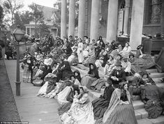 Extras are seen gathered on set