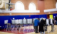 Voters cast their ballots at the Cunningham School in Milton, the polling location for precincts 6 and 7. — Greg Derr/The Patriot Ledger