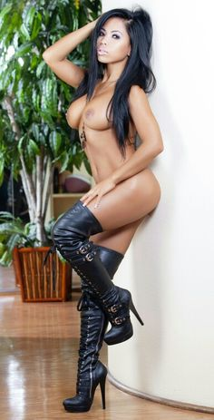Naked in thigh high boots