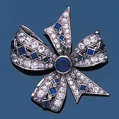 An early 20th century sapphire and diamond bow brooch, circa 1910 The tied ribbon bow finely pierced and millegrain-set with calibré-cut sapphires and single and brilliant-cut diamonds, with a circular-cut sapphire to the centre, later brooch fitting, width 3.5cm., cased