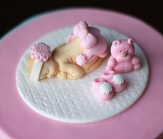 Fondant baby topper in pink with matching fondant booties and fondant bear.    Available at https://www.etsy.com/shop/LesPopSweets?ref=hdr_shop_menu