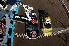 Kevin Harvick, driver of the #4 Jimmy John's Chevrolet, beats Carl Edwards, driver of the #19 Stanley Toyota, to the checkered flag to win the NASCAR Sprint Cup Series Good Sam 500 at Phoenix International Raceway on March 13, 2016 in Avondale, Arizona.