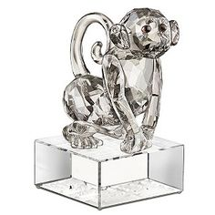 Innovative and charming. The characteristics of the Chinese Zodiac's Year of the Monkey, are brought to life in this beautiful ornament. Beautifully crafted, it sparkles in silver shade crystal and smoked topaz, with Moroda crystal pupils.