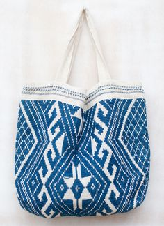 """@Laura Cornwall Collection Tote - hand woven from organic cotton and natural dyes by a village of women in Laos (@Megan Ward Williams!) All raw materials to create the natural dyes are grown in their village. Each textile takes three days for the women to weave. """"pin us, win us"""""""