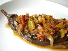Imam Bayildi (Braised Eggplant With Tomatoes) Recipe  http://www.yemek-tarifi.info/english/recipe.php?recipeid=40