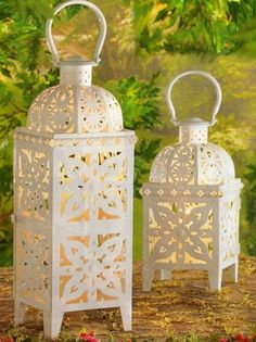 "Stunning is the word for these show-stopping oversized lanterns! Fire and ice creates a dramatic show as candlelight glimmers through Lush medallion cutout design with the appearance of a snowflake gets modern appeal from glossy snow-white finish; simply gorgeous as a candle glows from within.  Large: 7"" square x 25"" high   Medium: 7"" square x 19"" high   SALE $45.00-$30.00"