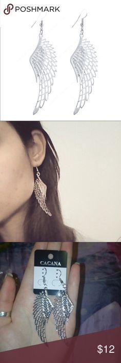 (i2) Silver Wings Earrings Beautiful silver toned earrings. New in package. Jewelry Earrings