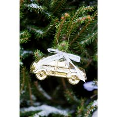 "At Rivière Maison, you can find all the most wondrous Christmas decorations in one place! This little vintage car is a lovely touch for any Christmas tree. Also available in """"silver"""" colour."