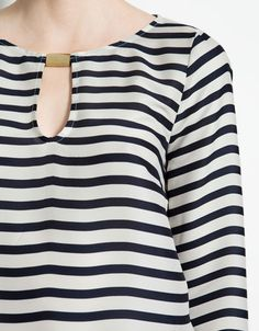 Zara STRIPED TOP WITH APPLIQUÉ. While this top was flattering and sophisticated, I think the 100% polyester construction would make it a sweat trap in the humid DC summer.