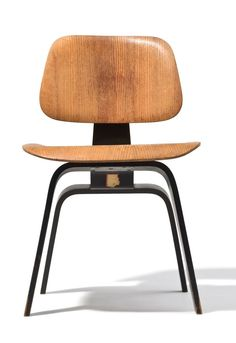 DCW prototype, Produced at the Eames Office prior to December 1945, Plywood with black aniline dye spine and legs, Exhibited: The Barclay Hotel, New York, December 1945; The Architectural League, New York, February 1946; The Museum of Modern Art, New york, March 1946.