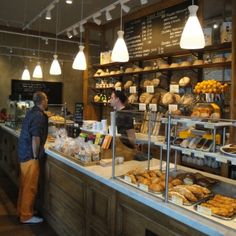 Skinflint's 'Skittle' opaline shades illuminate the counter in Le Pain Quotidien in Westfield London