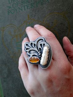 Exoskeleton ring. Sterling silver handmade jewelry, with stick pearl and carnelian. size 9. via Etsy.