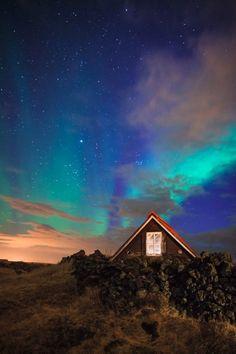 Aurora and sodium-vapor, Reykjavik, Iceland. 20 seconds, f/4, ISO 2500.