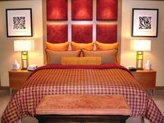 This custom headboard, including six separate panels stretching vertically up the back wall, not only completes the look of the bed but also creates a focal point for the entire room.