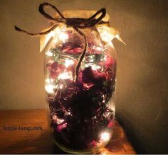 Pot-pourri and light cable are in a bottle. DIY