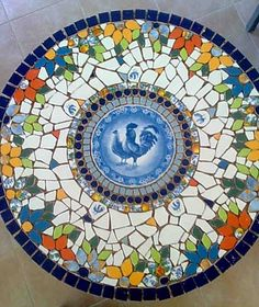 Mosaic table with flowers and blue hen