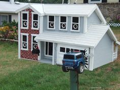 I've seen plenty of mailboxes that are replicas of houses, but this one puts ...  uglymailbox.com