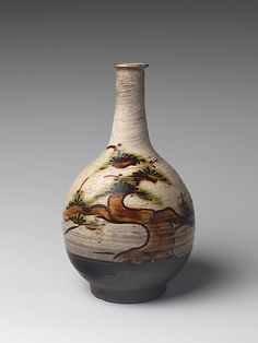 Bottle with Decoration of Pine Tree  Period: Edo period (1615–1868) Date: ca. mid-17th century Culture: Japan Medium: Stoneware with iron-painted design and copper-green glaze over brushed white slip (Takeo Karatsu ware)