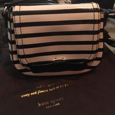 Kate Spade Bag Super cute cream and black Kate Spade bag with bow. This bag is authentic and comes with a Kate spade dust bag. Only carried once. In great condition! Height 4 1/2 inches, Length 7 inches. Adjustable strap and snap closure. kate spade Bags Mini Bags