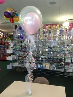 Double stuffed balloon centerpiece with tulle and ribbons. Beautiful for showers this retails at $11.99
