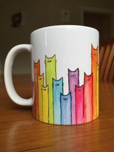 Cat Mug, Rainbow Mug, Cat Lovers Mug, Coworker Gift, Rainbow of Cats Ceramic Mug, Perfect Gift for Cat Lovers  A fun ceramic mug featuring my original watercolor painting. These will make perfect holiday gifts for tea and coffee drinkers or any Cat lovers!  - 11 oz, approx. 3 3/4 tall - Image wraps around the mug - Microwaveable - Dishwasher safe  Matching Art Print: www.etsy.com/listing/252589654  Back to my shop olechkadesign.etsy.com
