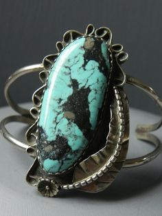 Sizable Vintage Native American Turquoise and Sculpted & Stamped Silver Cuff Bracelet. via Etsy.