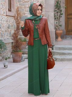 Hunter green two-piece dress with long skirt and brown leather jacket