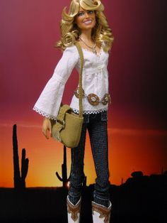 Farrah Barbie - I think this is the Mattel Barbie that has been rebodied and redressed - Nice choice of clothing for her!