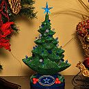 Memory Company Dallas Cowboys Christmas Tree Figurine. Features Resin Christmas tree figurine Two sets of small plastic bulbs in the team colors Decorated with the team logo Candelabra base bulb Lamp cord with on/off switch Officially licensed. Price: $59.99