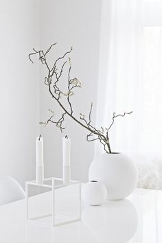 We just love Cooee Design, this innovative design company is based deep in the forests of Småland, Sweden. Cooee Design started out as an interior design company in 2008 producing products for the home encompassing classical elements of interior design. Table Diy, By Lassen, Round Vase, Interior Design Companies, White Aesthetic, Shades Of White, Minimalist Home, Scandinavian Style, Innovation Design