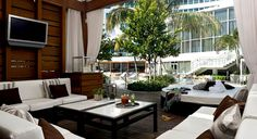 Private cabanas provide perfect poolside seating ~ Fountainebleau Miami Beach ~ Love this hotel!!!