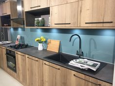 Brighten up your kitchen wall with AluSplash. Your modern alternative for glass, acrylic, and tiles splashbacks. Our high-gloss and fire-resistant products are durable & easy to clean & maintain. Splashback, Beautiful Kitchens, Blue Bird, Laundry Room, Kitchen Ideas, Tiles, Kitchen Cabinets, Modern, Inspiration