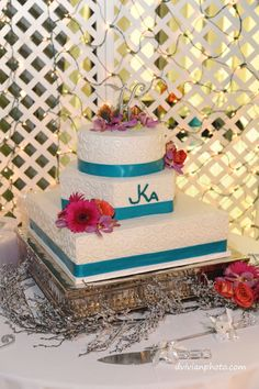 """Wedding cake w/ our """"logo"""" JKA. White on white scroll icing, teal ribbon & real flowers."""