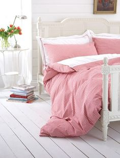 Recreate a Scandanavian look in your bedroom. Red and white gingham is an obvious and authentic choice for this kind of scheme. Team with hand painted white furniture and wooden floorboards for a classical Nordic style. Bed linen by Peacock Blue. #bedroom #interiordesign