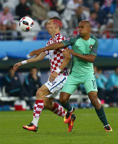 #EURO2016 Ivan Perisic of Croatia in action against Joao Mario of Portugal during the Euro 2016 round of 16 football match between Croatia and Portugal at...
