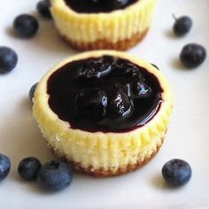 Mini cheesecake with a blueberry sauce. The secret? Coconut flakes in the graham cracker crust!