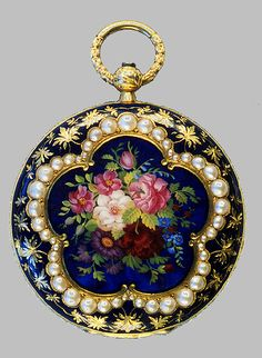 *VICTORIAN ~ 18kt gold enamel watch:this beautiful enameled hunter case pendant watch features a wonderful bouquet of coloroful flowers surrounded by hald bead pearls set in a scalloped rim amidst a rich blue enameled backfield, sprinkled w/ gold leaves + vines. The case is 18kt yellow gold.  WELL OVER 150 YRS OLD !