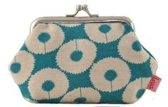 Beautiful dandelion design frame purse in turquoise. Top quality calico material, with dotty cotton lining. This fun, frame coin purse is slightly larger than most coin purses giving you just enough space for essentials such as money, credit card, front door key and a lipstick - perfect for a night out when a handbag is just too much hassle! The purse has a silver metal frame, is hand made from thick cotton and is fully lined inside with a contrasting print for added style. Stylish and…