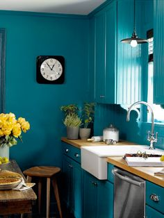Go for broke! Bathe everything—walls, cabinets, and trim—in high-gloss teal to turn a pint-size kitchen into a gleaming jewel box.