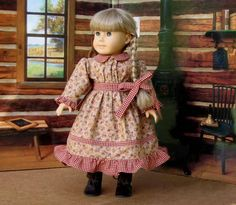 """Kirsten Prairie School Dress and Matching by SewFunDollClothes - The designer dress fabric is Benartex """"Acorn Hollow"""" by Nancy Halvorsen; it is a warm rust brown with burgundy and green acorns; the contrasting collar, waistband, and ruffles are burgundy and tan gingham. The front bodice is gathered into the gingham waistband in the front; sleeves are gathered at the shoulders and have gingham ruffles at the wrists; the full skirt has a decorative gingham stripe and ruffle around the hemline."""