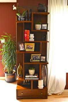 Can be both a bookcase and a regular shelf. I like utilitarian.