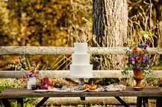 Rustic desert table set-up using cutting-garden style flowers and foliage and fruit