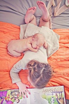 I love that the big sister is totally unaware of the baby sleeping on her back. Perfect photo for the sister shared bedroom. Table, Furniture, Home Decor, Homemade Home Decor, Tables, Home Furniture, Interior Design, Decoration Home, Home Interiors